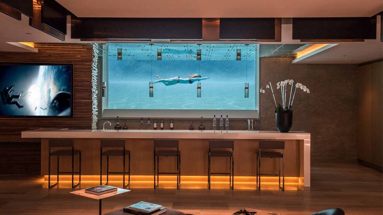 Check out this amazing home and Pool – And the Wine Rack!!