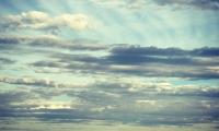 view ocean mountains cloudy