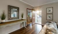 living room front door open sun rays